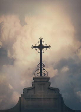 Mark Owen IRON CROSS IN CLOUDY NEW ORLEANS CEMETERY Statuary/Gravestones