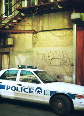 Mark Owen NEW ORLEANS POLICE CAR BY GRAFFITIED WALL Cars