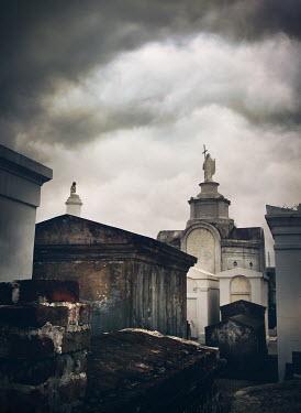 Mark Owen NEW ORLEANS CEMETERY UNDER CLOUDY SKY Statuary/Gravestones