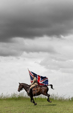 Stephen Mulcahey cavalry officer riding horse with union jack flag Men