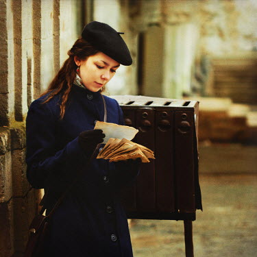 Natalia Ciobanu YOUNG VINTAGE WOMAN WITH LETTERS BY MAIL BOX Women