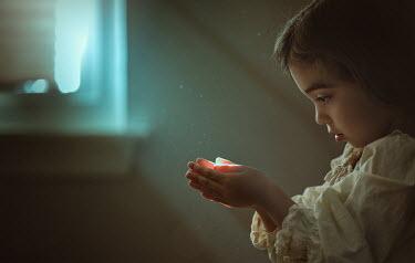 Lilia Alvarado LITTLE GIRL HOLDING LIGHT IN HANDS Children