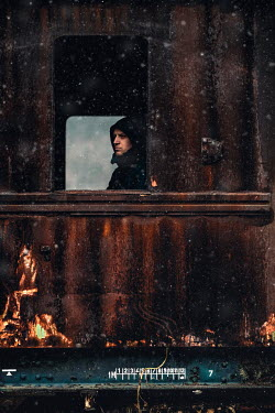 Dragan Todorovic MAN LOOKING OUT DERELICT TRAIN WINDOW Men