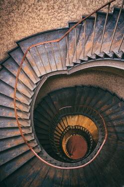 Jaroslaw Blaminsky RUSTY SPIRAL STAIRCASE LEADING DOWNWARDS Stairs/Steps