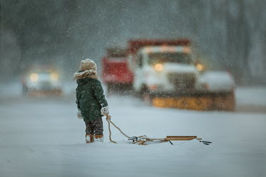 Lilia Alvarado LITTLE BOY WATCHING SNOW PLOWS IN BLIZZARD Children