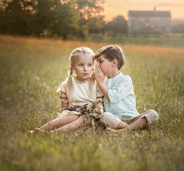 Lilia Alvarado LITTLE BOY AND GIRL SITTING IN FIELD Children