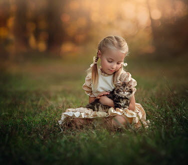 Lilia Alvarado LITTLE GIRL SITTING WITH CAT IN FIELD Children