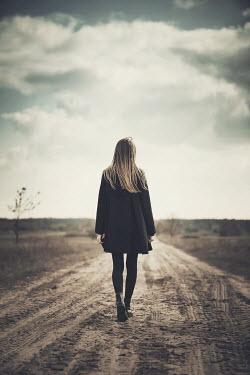 Dorota Gorecka YOUNG WOMAN WALKING ON COUNTRY PATH Women