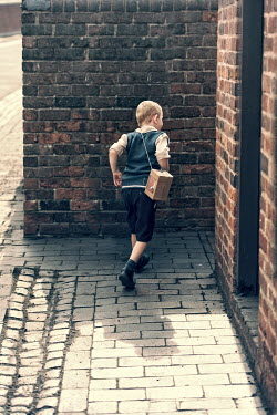 Lee Avison 1940s wartime boy running in cobbled alleyway Children