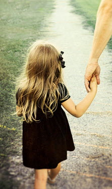 Buffy Cooper LITTLE GIRL HOLDING PARENTS HAND IN COUNTRYSIDE Children