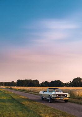 Ysbrand Cosijn MAN DRIVING CLASSIC CAR IN COUNTRYSIDE Men