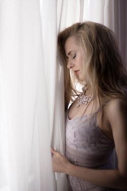 Dan Tidswell YOUNG BLONDE WOMAN IN LINGERIE BY WINDOW Women