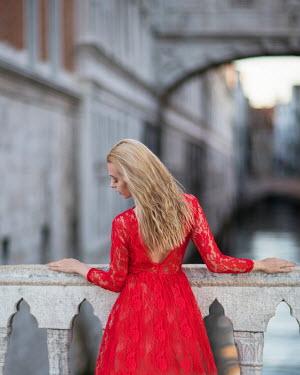 Dan Tidswell GLAMOROUS BLONDE WOMAN BY BRIDGE IN VENICE Women