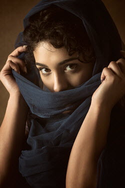 Mohamad Itani YOUNG MUSLIM WOMAN COVERING MOUTH WITH SCARF Women