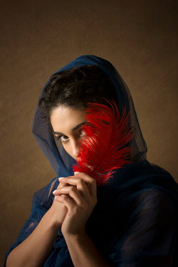Mohamad Itani YOUNG MUSLIM WOMAN HOLDING FEATHER Women