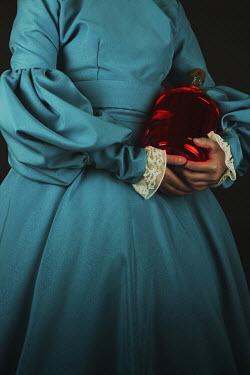 Sara Helwe HISTORICAL WOMAN HOLDING RED BOTTLE Women