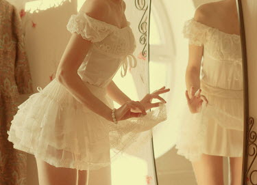 Hellen vintage woman in petticoat looking in mirror Women