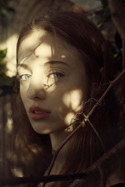 Marta Bevacqua YOUNG WOMAN WITH LEAF SHADOWS ON FACE Women