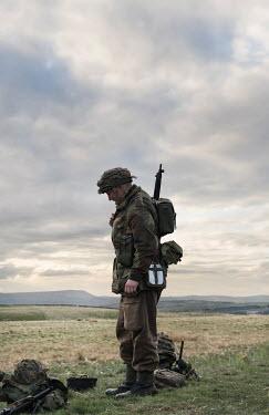 Stephen Mulcahey 1940s british paratrooper standing in field Men