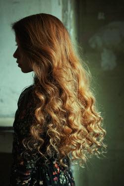 Marta Bevacqua WOMAN WITH LONG CURLY HAIR IN SHADOWS Women