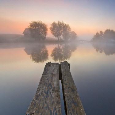 Leszek Paradowski HOUSE AND JETTY BY LAKE AT SUNSET Lakes/Rivers