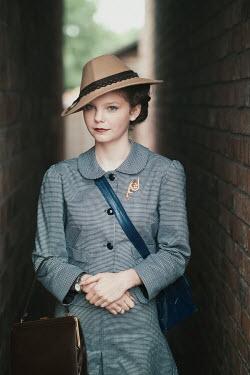 Lee Avison YOUNG 1940S WOMAN IN BRICK ALLEYWAY Women