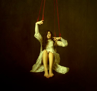 Maren Klemp WOMAN AS PUPPET WITH RED STRING Women