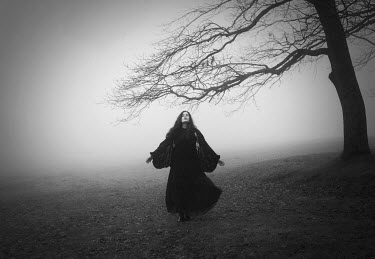 Maren Klemp GOTHIC WOMAN BY TREE IN FOG Women