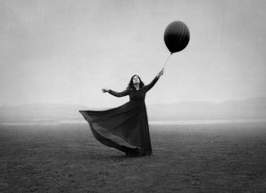 Maren Klemp WOMAN WITH BALLOON ON DESOLATE BEACH Women