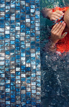 Mary Schannen WOMAN IN SWIMMING POOL WITH BLUE TILES Women