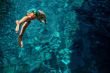 Mary Schannen BOY DIVING INTO SWIMMING POOL Children