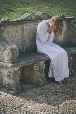 Holly Leedham WOMAN CRYING ON ORNATE STONE BENCH Women