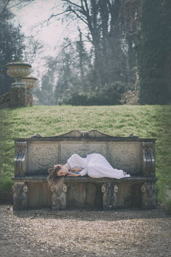 Holly Leedham WOMAN LYING ON ORNATE STONE BENCH Women