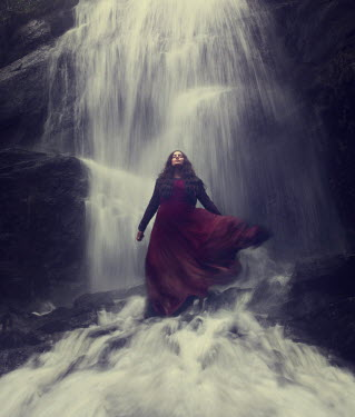 Maren Klemp TIMELESS WOMAN STANDING UNDER WATERFALL Women