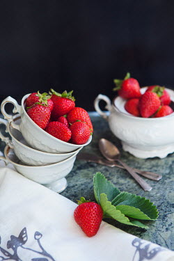 Isabelle Lafrance STRAWBERRIES IN WHITE BOWLS ON TABLE Miscellaneous Objects