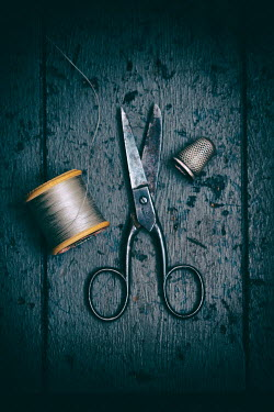 Lee Avison SCISSORS, THREAD AND THIMBLE ON TABLE Miscellaneous Objects