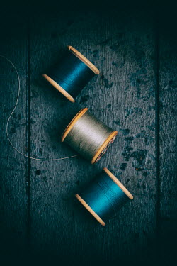 Lee Avison THREE COTTON REELS ON WOODEN TABLE Miscellaneous Objects