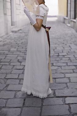 Ildiko Neer REGENCY WOMAN WITH FAN ON COBBLED STREET Women