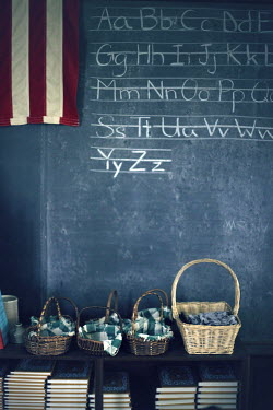 ILINA SIMEONOVA WRTING ON BLACKBOARD IN VINTAGE SCHOOL ROOM Interiors/Rooms