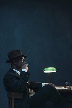 Ysbrand Cosijn BLACK MAN SMOKING AT DESK AT NIGHT Men