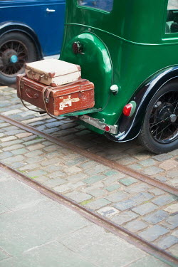 Lee Avison vintage car with luggage rack and leather suitcases Cars