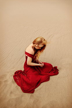 Buffy Cooper BLONDE WOMAN IN RED DRESS ON SAND Women