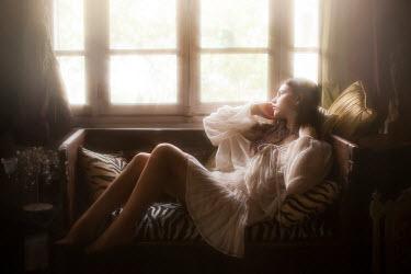 Vivienne Mok GIRL LYING ON SOFA BY WINDOW Women