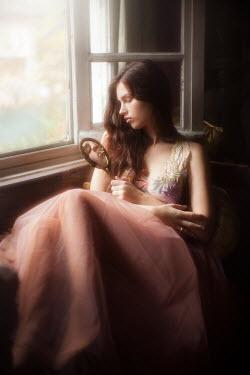 Vivienne Mok GIRL LOOKING AT MIRROR BY WINDOW Women
