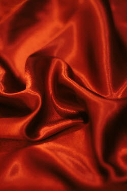 Holly Leedham CLOSE UP OF ORANGE SILK FABRIC Miscellaneous Objects