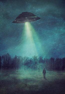 Drunaa silhouette of man under flying saucer at night Men