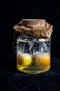 Kelly Sillaste YELLOW EGGS IN GLASS BOTTLE Miscellaneous Objects