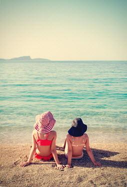Svetlana Bekyarova TWO YOUNG GIRLS SITTING ON BEACH Children