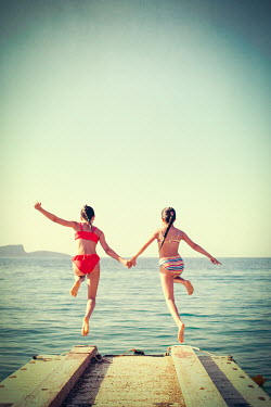 Svetlana Bekyarova TWO YOUNG GIRLS JUMPING OFF PIER Children