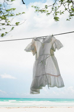 Terry Bidgood WHITE DRESS HANGING BY SANDY BEACH Seascapes/Beaches